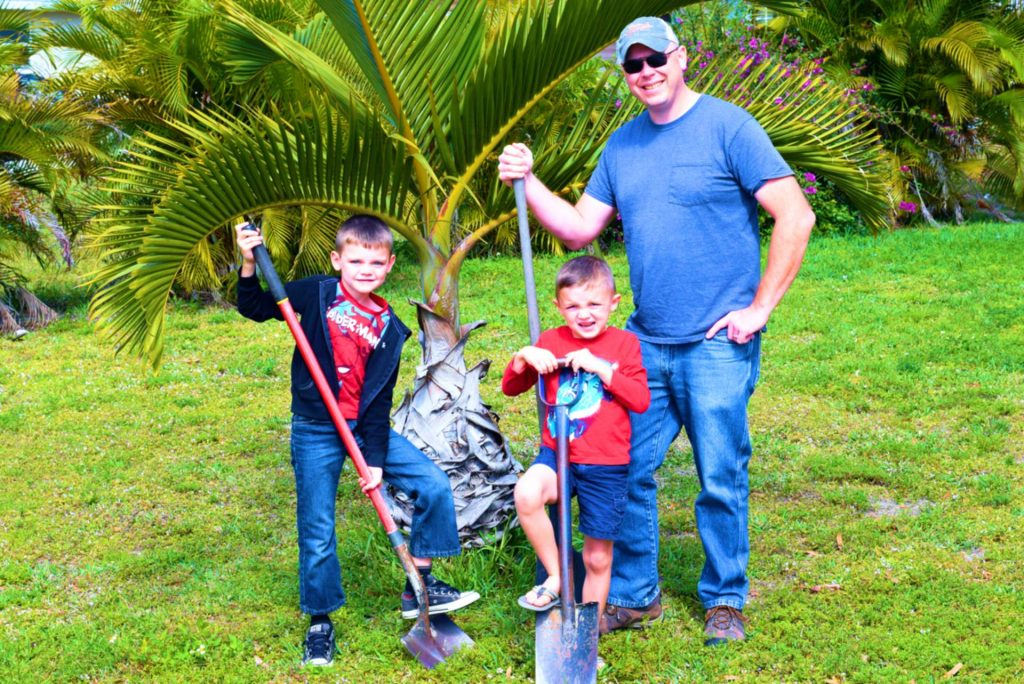 Me and boys planting palms 1
